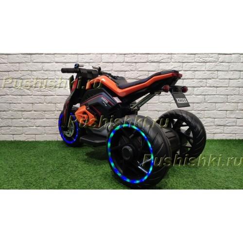 Детский электромотоцикл RiverToys X222XX (трицикл) со светящимися колесами